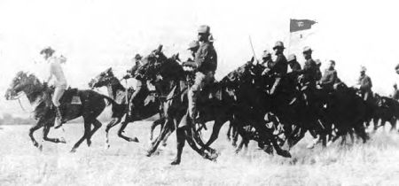 Quartermaster Sergeant Paschal Conley II leading a charge of Troop M, 10th Cavalry Regiment. Circa 1899. Public domain.